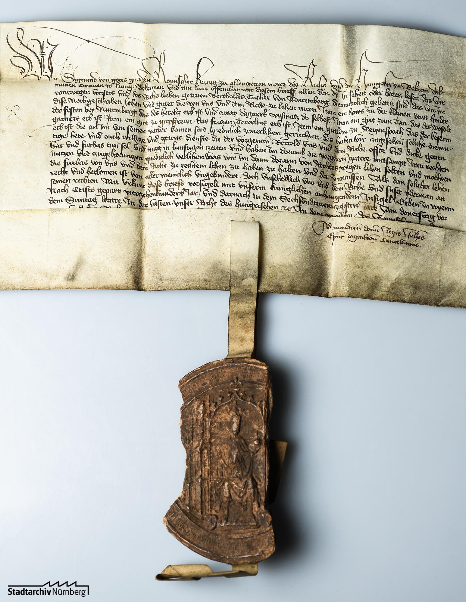 Lehenbrief Kaiser Sigismunds für Berthold Tucher über die Güter zu Regelsbach, Thon, Geisreuth und Kleinreuth